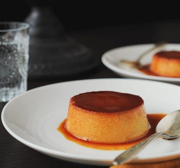 Pumpkin Leche Flan on a white dish.