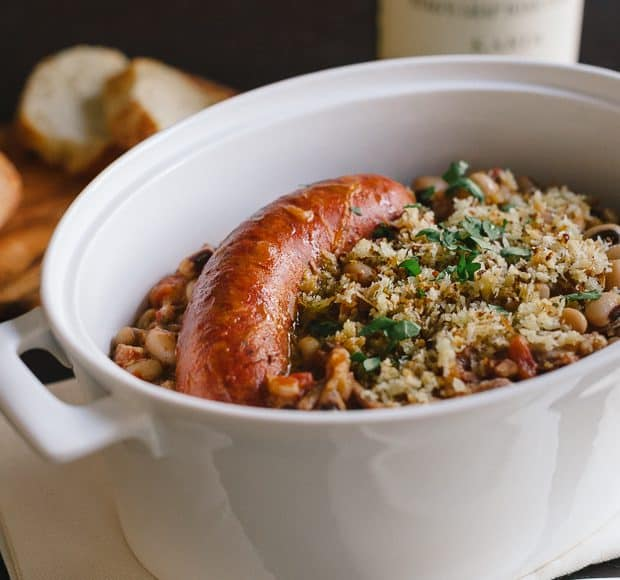 Black Eyed Pea Cassoulet with sausage in a serving dish.