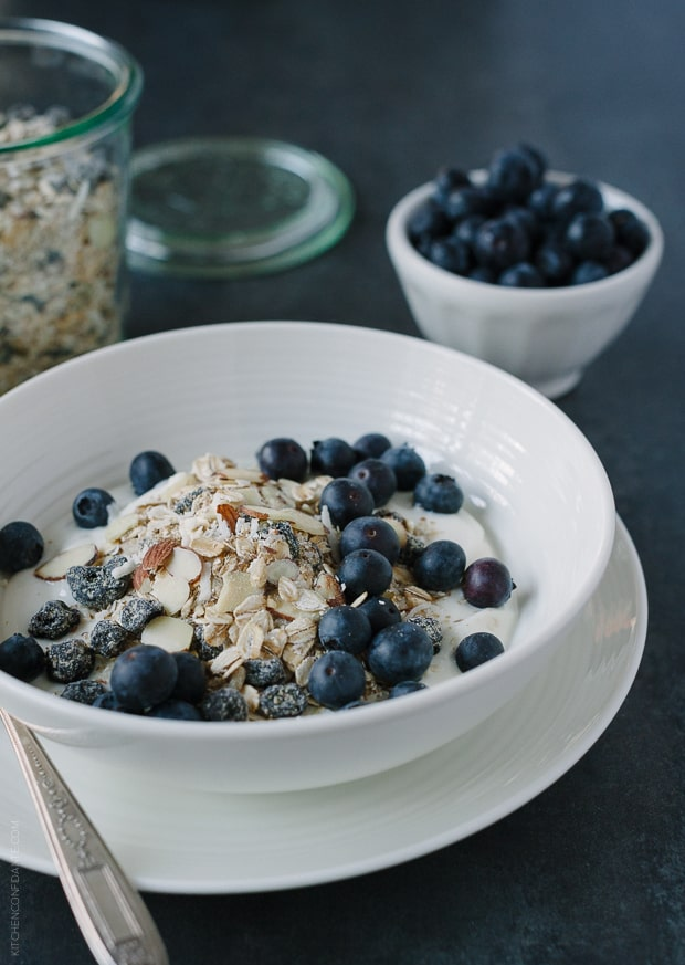 Blueberry Muesli served over yogurt in a white bowl.