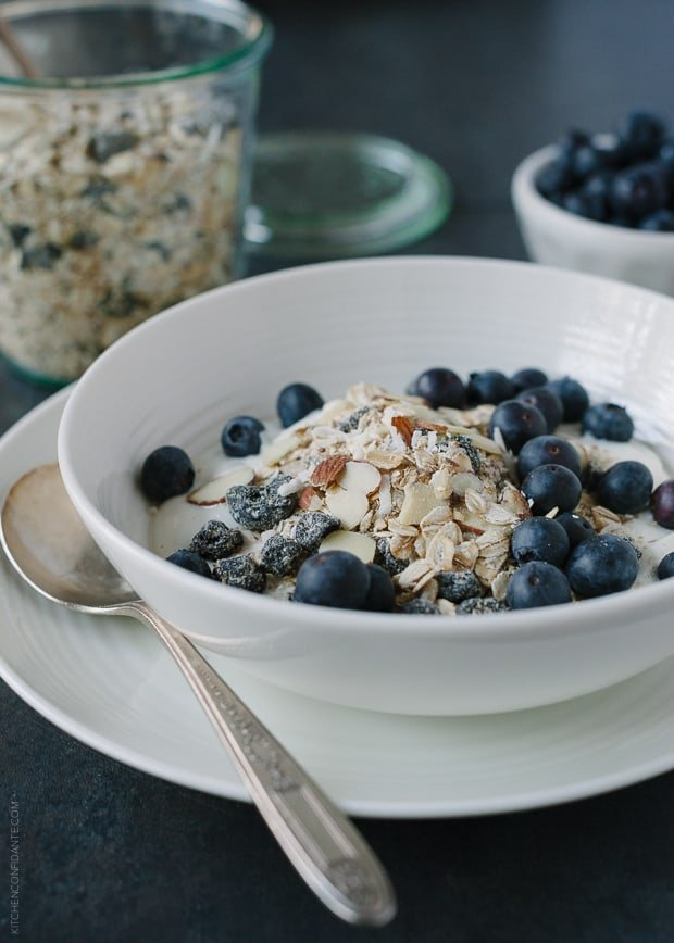 A bowl of Blueberry Muesli topped with fresh blueberries.