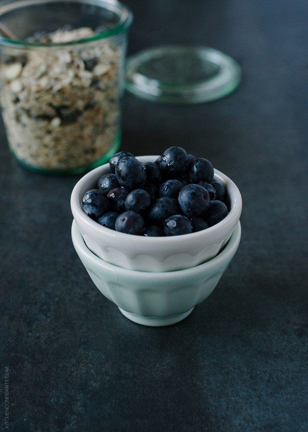 Small bowl filled with fresh blueberries.