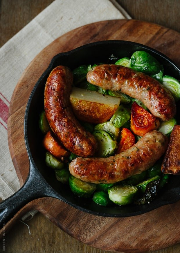 Cast iron pan filled with Roasted Chicken Sausages with Brussels Sprouts, Fennel and Potatoes.