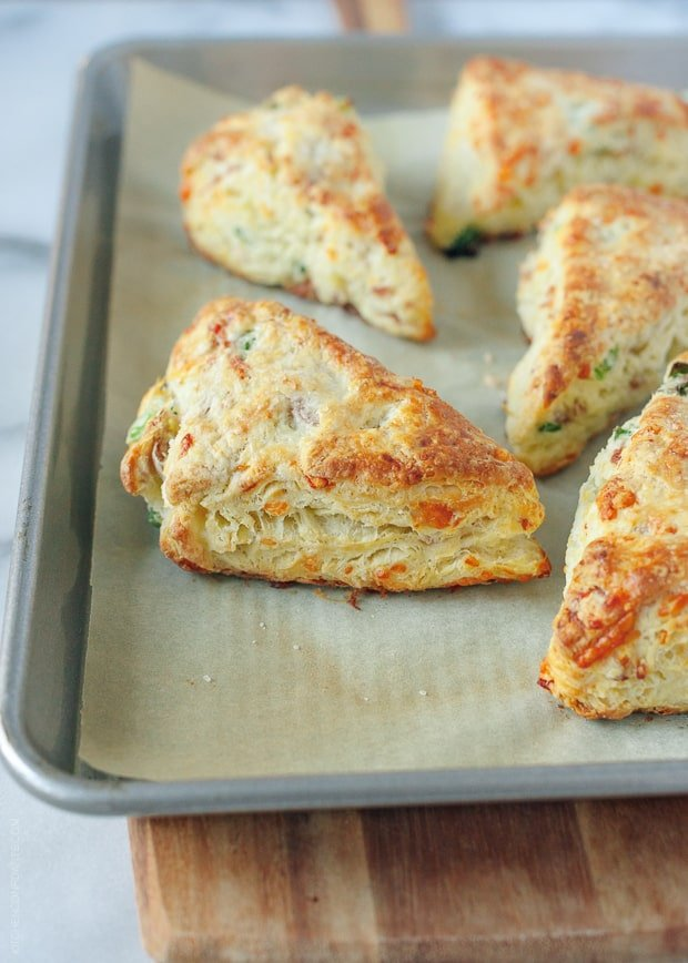 Savory Scones with Gruyere, Prosciutto and Green Onion on a baking sheet