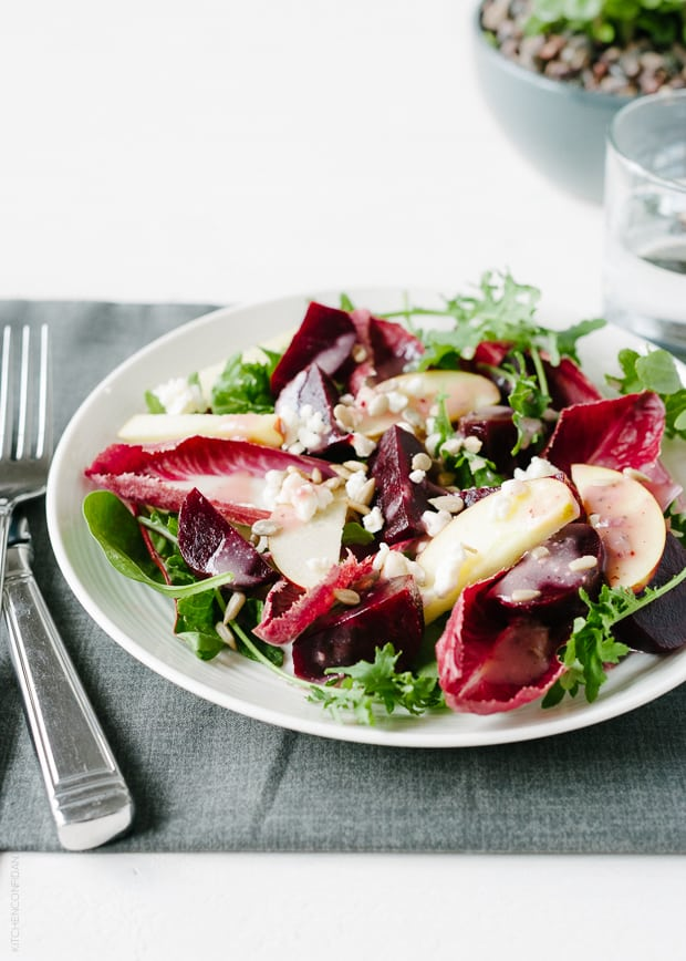 Endive leaves tossed in a plate of salad.