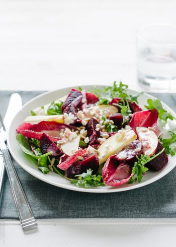 A large plate filled with Apple Beet Salad, Endive and Baby Greens.