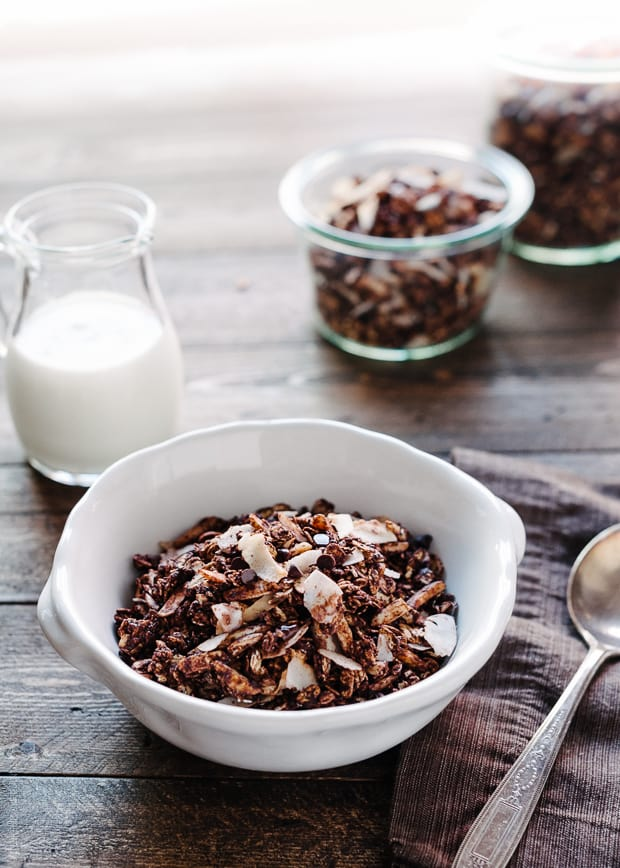 A bowl of Mocha Coconut Granola on a wooden surface.