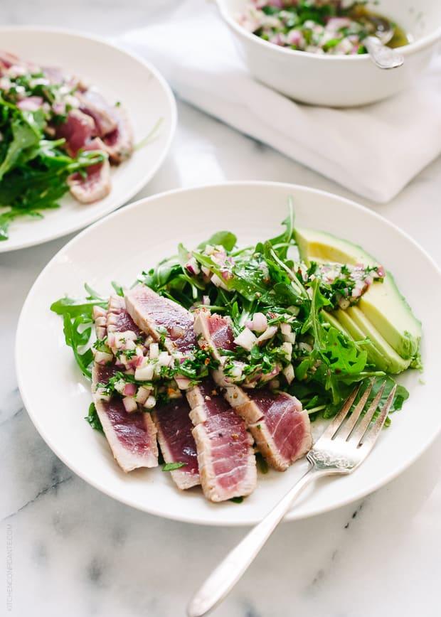 Seared Ahi Tuna with Chimichurri Sauce on a white plate.