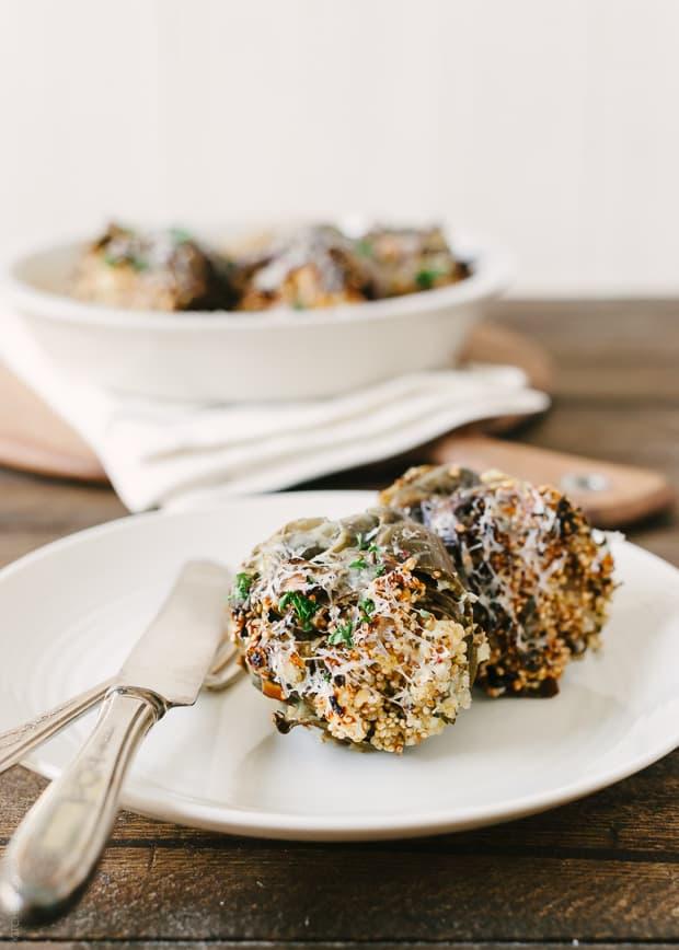 Cheesy Toasted Quinoa Stuffed Artichokes on a plate.