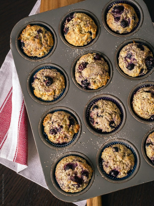 A muffin tin filled with Berry Flaxseed Muffins.