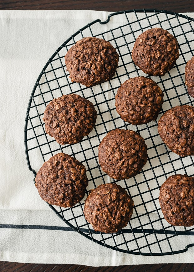 A cooking rack filled with homemade Chocolate Oatmeal Cookies.