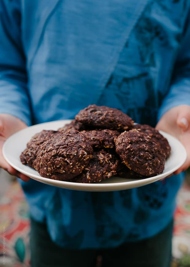 Holding a plate of Oatmeal Chocolate Cookies.