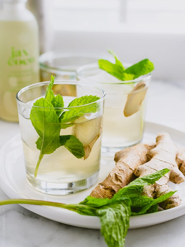 Ginger-Mint Coconut Water Coolers garnished with mint and ginger.