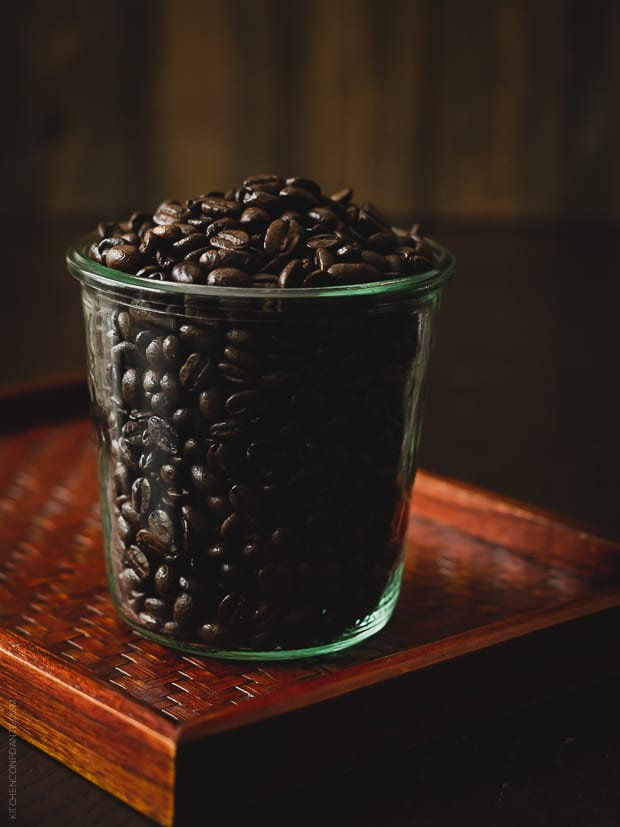 Coffee beans in a glass jar.