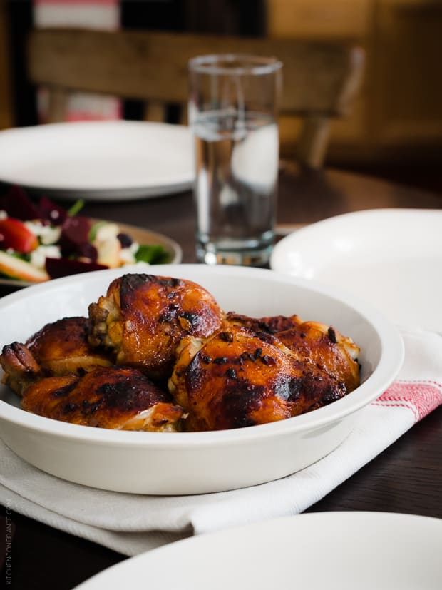 A large serving dish filled with Honey Spice Marinated Grilled Chicken.
