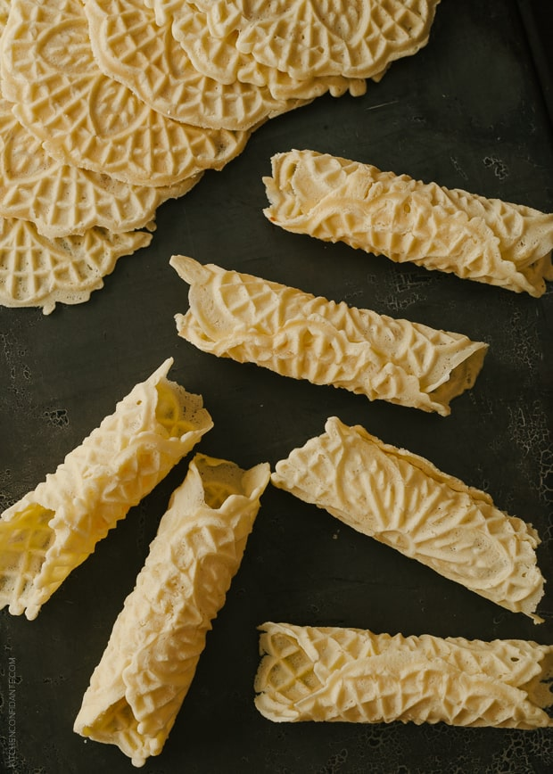 Rolled Pizzelle on a dark background.