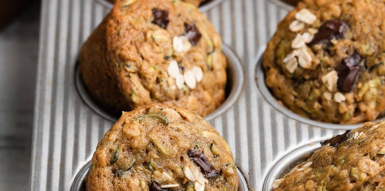 Zucchini Oat Chocolate Chunk Muffins in a muffin pan.