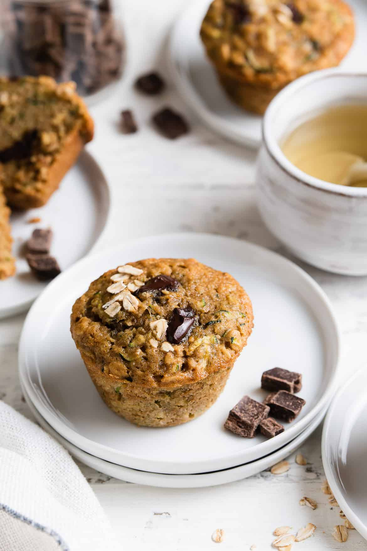 Zucchini Oat Chocolate Chunk Muffins on a small white muffin.