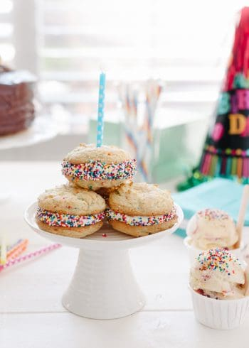 Birthday Cake Sandwich Cookies arranged on a small cake stand.