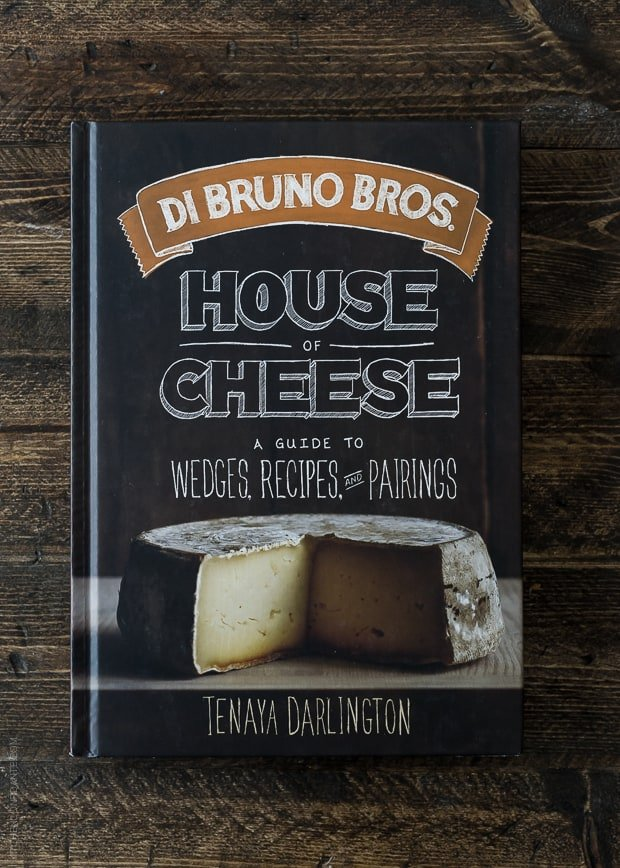 Di Bruno Bros House of Cheese Cookbook on a wooden surface.