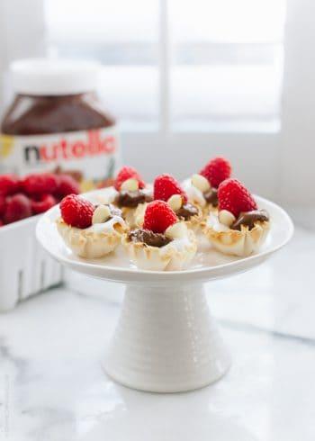 Nutella Greek Yogurt Phyllo Cups on a cake stand.