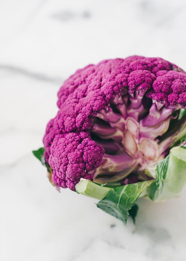 A purple cauliflower on a marble background.