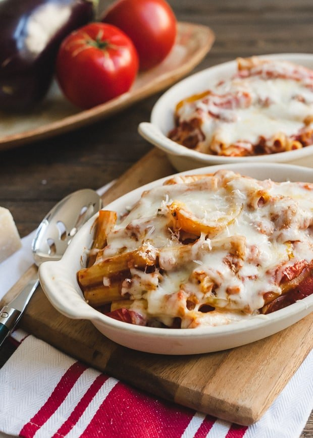 Portions of Baked Ziti with Roasted Eggplant and Peppers in white baking dishes.