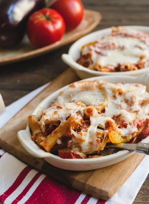 Baked Ziti with Roasted Eggplant and Peppers in a white baking dish.