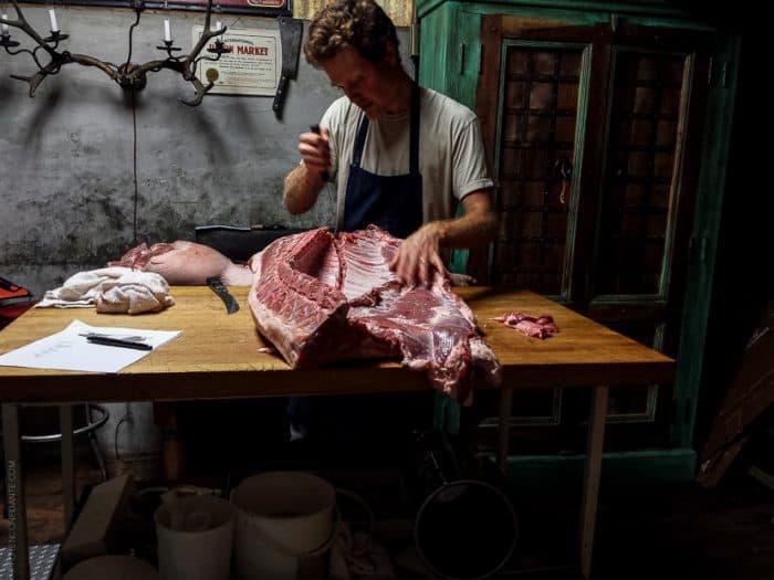 A man breaking down a hog at Advanced Butchery Class - Avedano's SF.