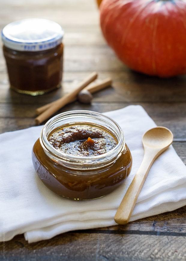 A glass jar of homemade maple pumpkin butter.