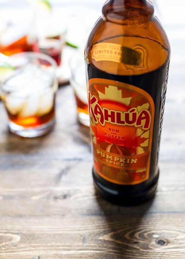 A bottle of Kahlua Pumpkin Spice on a wooden surface.
