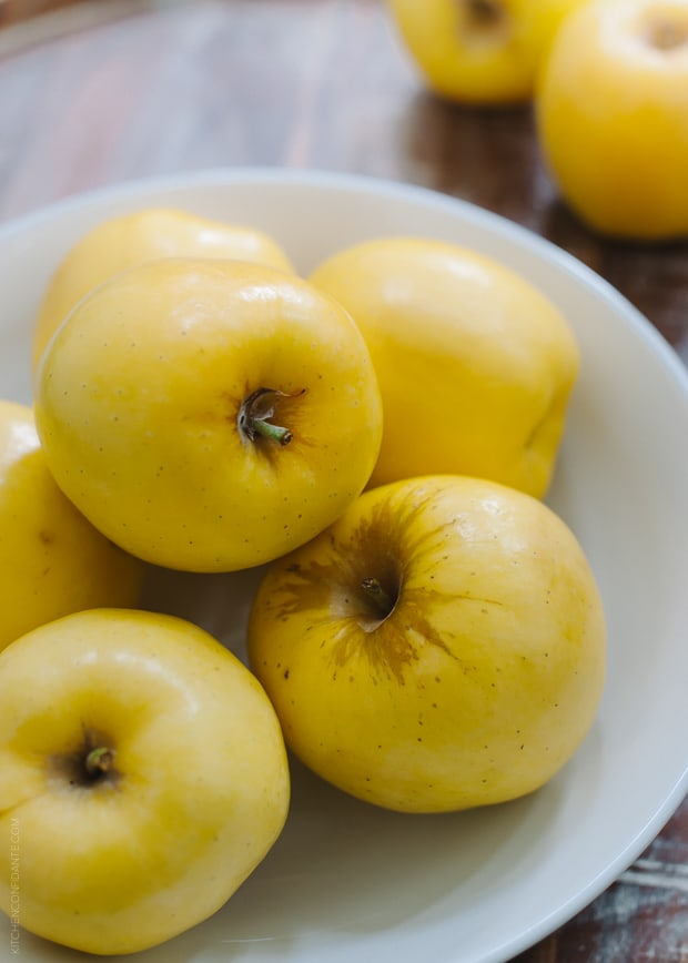 A bowl of yellow Opal apples.