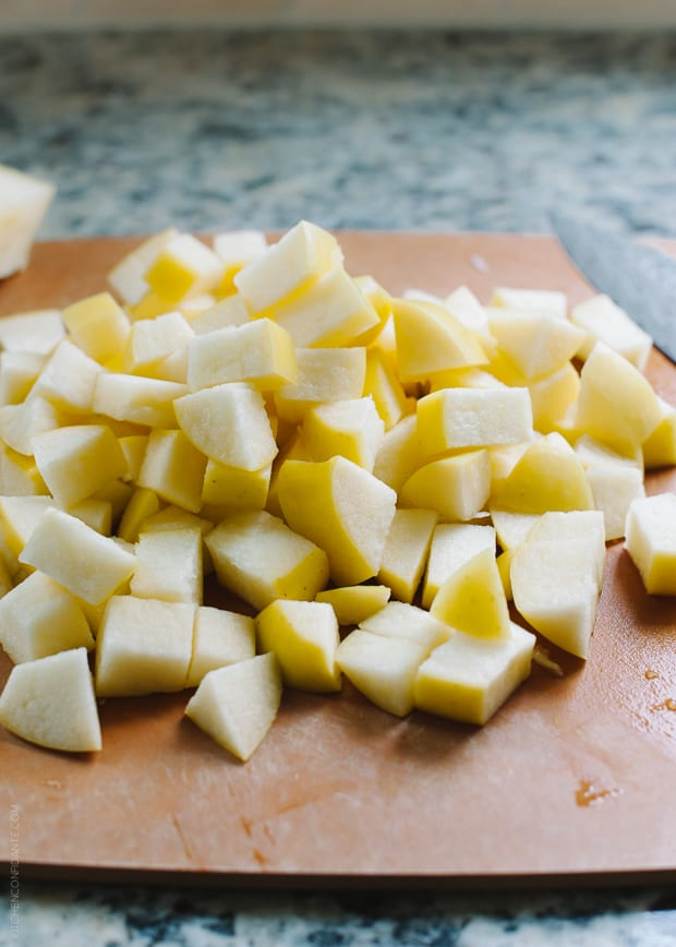 Chopped apples on a cutting board.