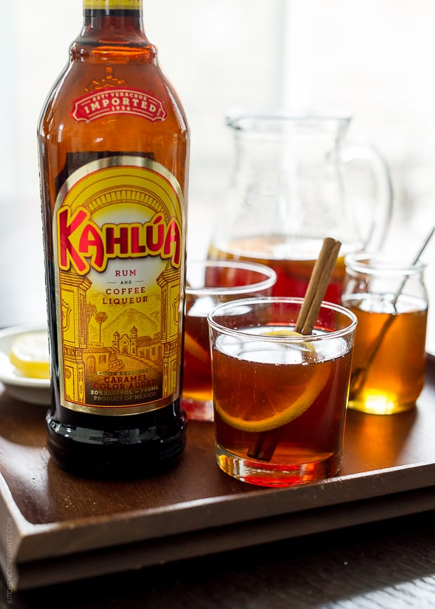 Kahlúa bottle alongside a Chai Hot Toddy in a glass.