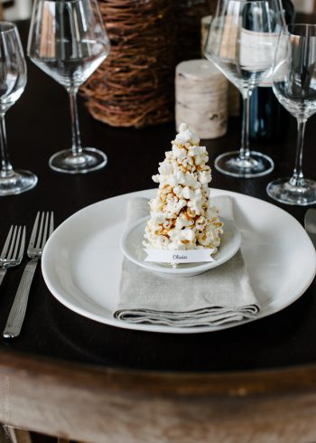 A place card made from popcorn and caramel shaped into a Christmas tree.