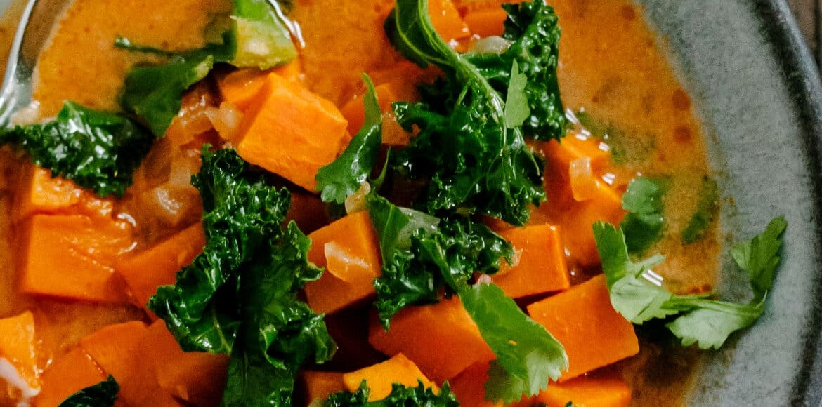 Sweet Potato and Kale Coconut Curry Soup | www.kitchenconfidante.com