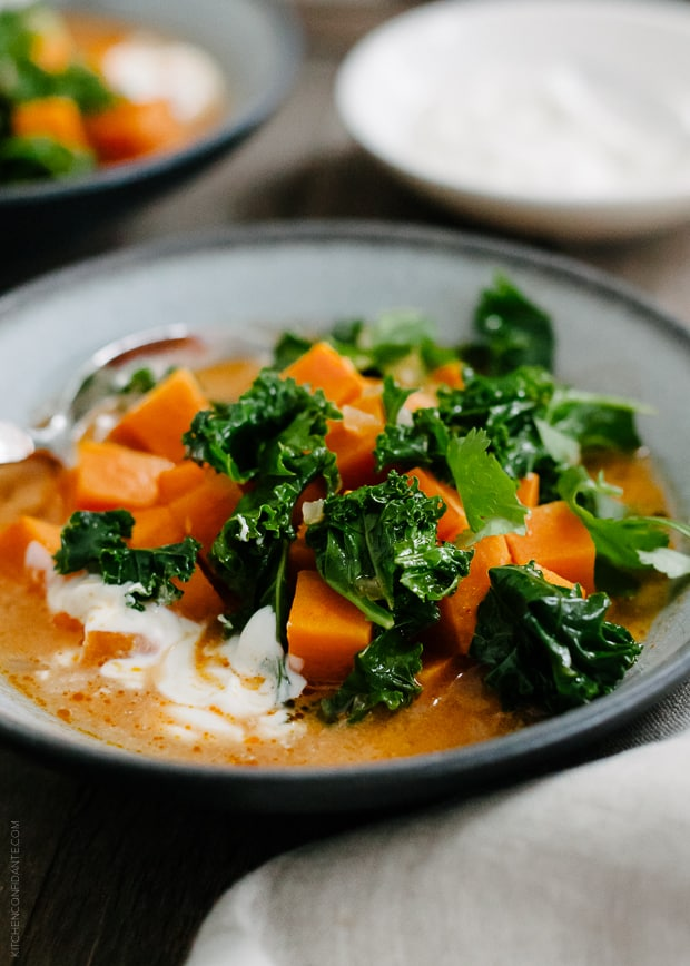 Sweet Potato and Kale Coconut Curry Soup in a grey bowl.