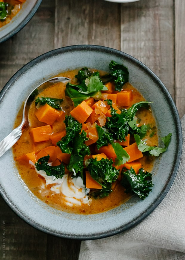 Sweet Potato and Kale Coconut Curry Soup in a grey bowl