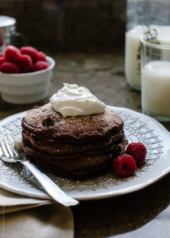"Eggless Chocolate Pancakes | www.kitchenconfidante.com | Out of eggs or need to omit them? Make these dark chocolate pancakes with a flaxseed ""egg"" substitute."