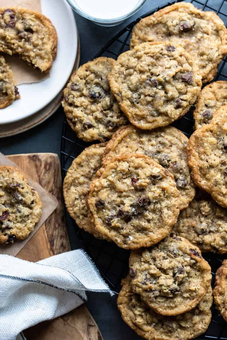 A stack of Chocolate Chip Cranberry Oat Cookies alongside a tall glass of milk.