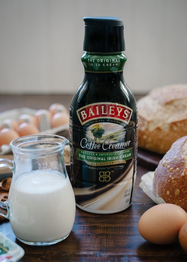 A bottle of BAILEYS Coffee Creamer with a small glass pitcher filled with creamer alongside.