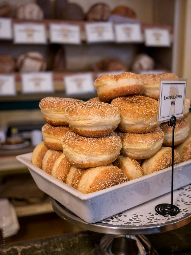 English Muffins displayed in a bakery.