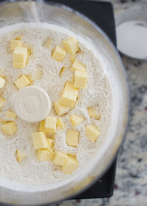 Cubed butter on top of the dry ingredients in a food processor to make Boursin Garlic & Herb Buttermilk Biscuits.