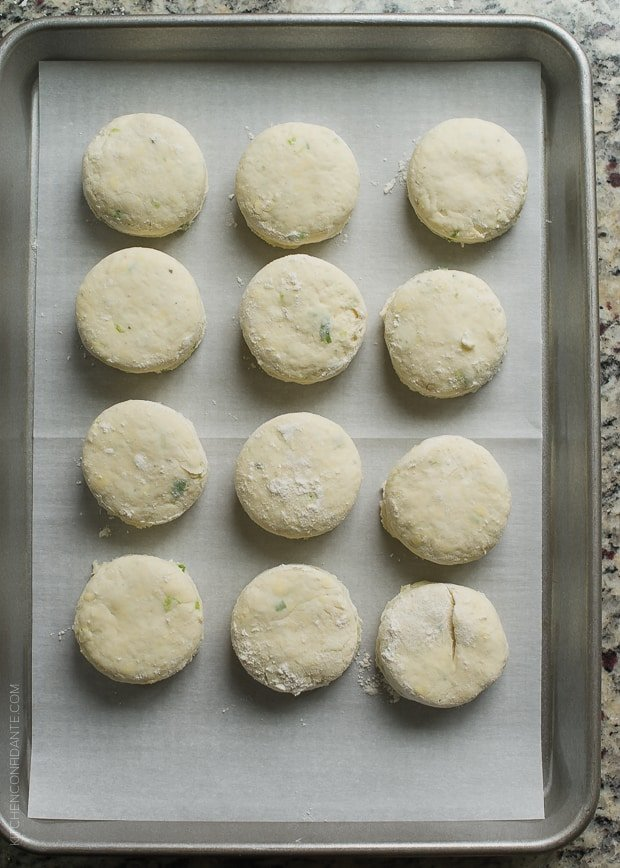 Ready-to-bake biscuits on a baking tray.