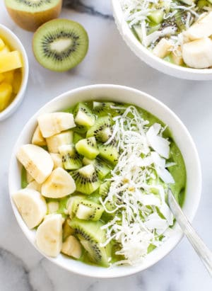 Green Smoothie Bowl topped with kiwi and banana in a white bowl