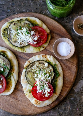Roasted Eggplant, Tomato and Pesto Mini Naan on a wooden serving board.