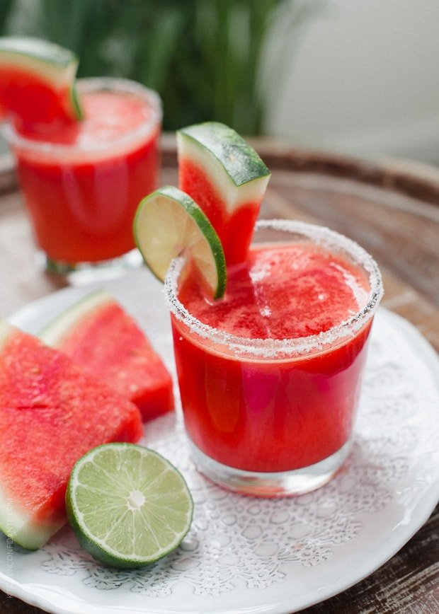 A watermelon lime margarita in a salt-rimmed glass.