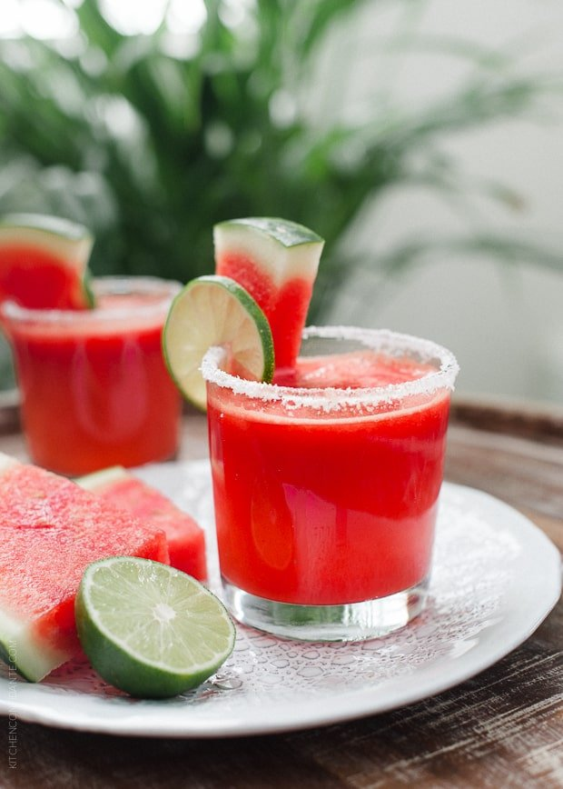 A Watermelon Lime Margarita surrounded by slices of fresh watermelon.