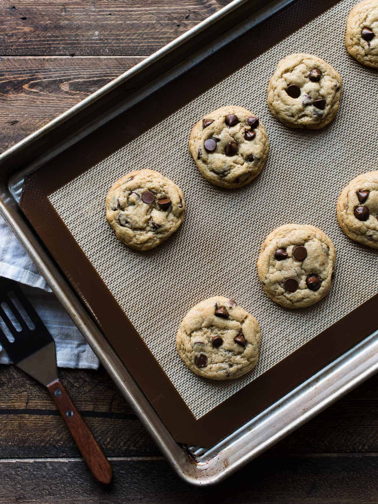 A combination of cream cheese, butter and one more special ingredient makes for a simple dough and perfectly tender cookies. You'll love this recipe for Cream Cheese Chocolate Chip Cookies. #cookie #creamcheese #chocolatechip #chocolate #recipe #cookies