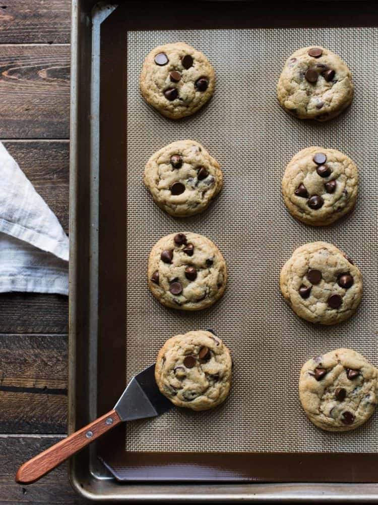 Cream Cheese Chocolate Chip Cookies are my go-to cookie recipe! A combination of cream cheese, butter and one more special ingredient makes for a simple dough and perfectly tender cookies. This recipe for Cream Cheese Chocolate Chip Cookies is my go-to when I'm craving a cookie. #cookie #creamcheese #chocolatechip #chocolate #recipe #cookies