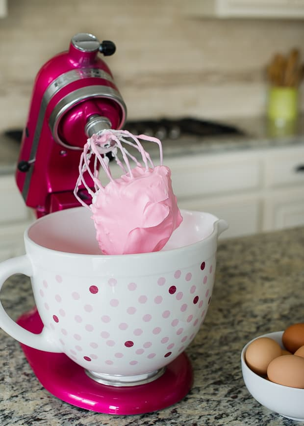 Pink meringue in a KitchenAid stand mixed ready to prepare a Raspberry Meringue Roll.